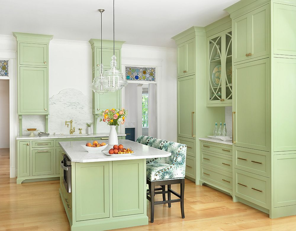 Pastel green gives a lovely, bright aura to the transitional kitchen