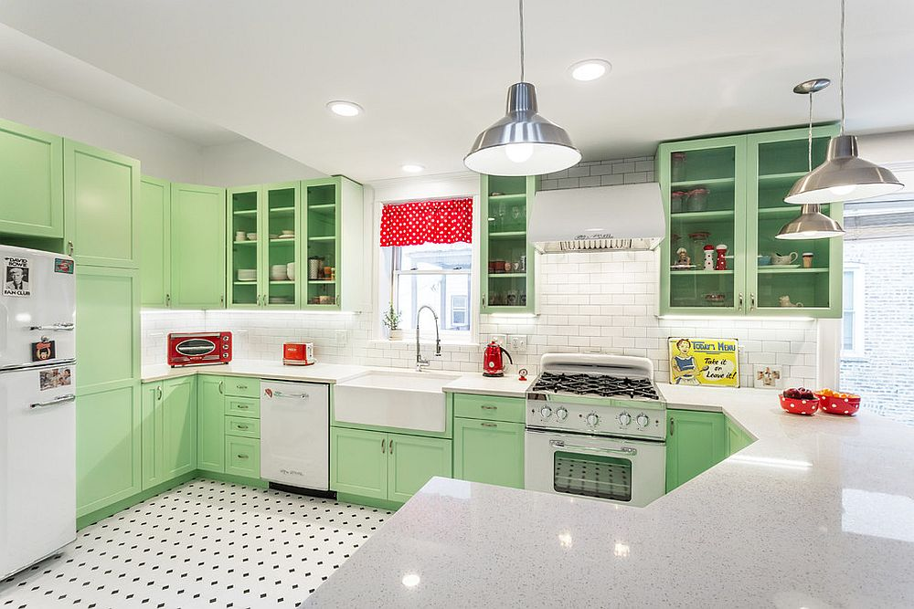 Pastel green kitchen cabinets add color to the space without going over the top