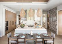 Pendants-with-organic-natural-materials-make-a-big-impact-in-the-white-beach-style-kitchen-217x155