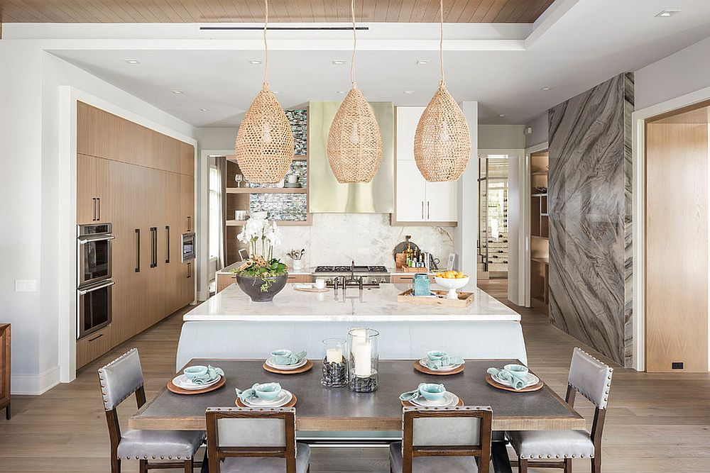 Pendants with organic, natural materials make a big impact in the white beach style kitchen