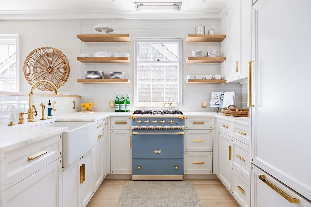 Perfect way to highlight th colorful appliance in the white kitchen