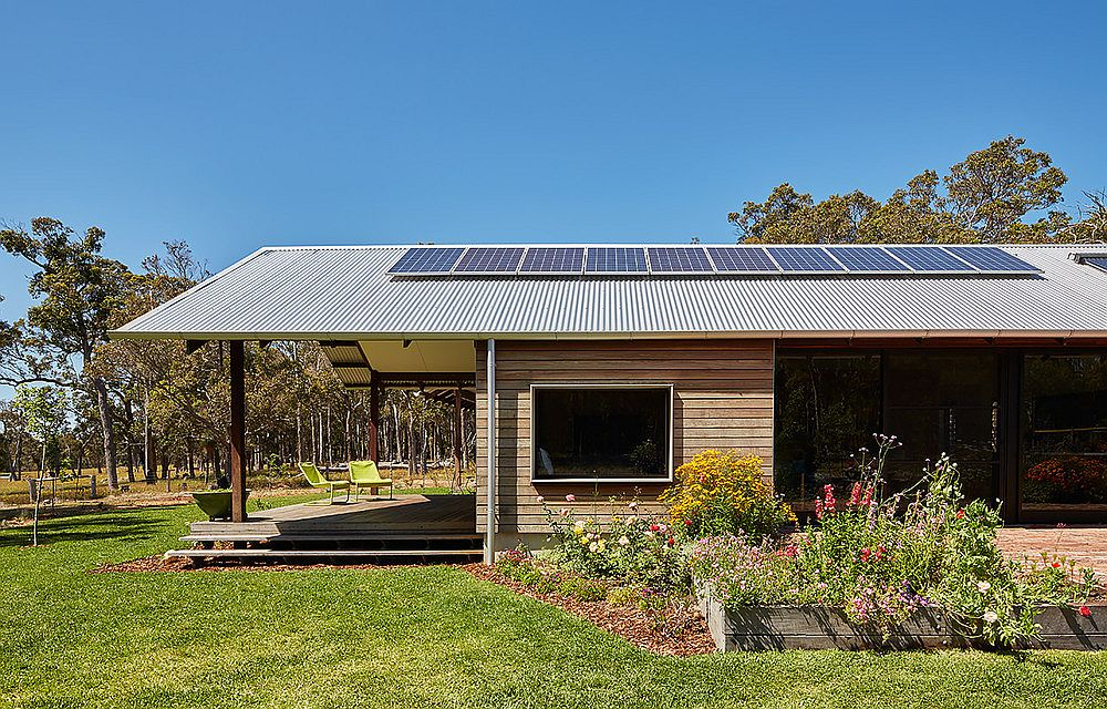 Photovoltaic panels that power the farmhouse sit on the roof