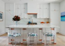 Polished-beach-style-kitchen-of-Palm-Beach-home-with-acrylic-bar-stools-217x155