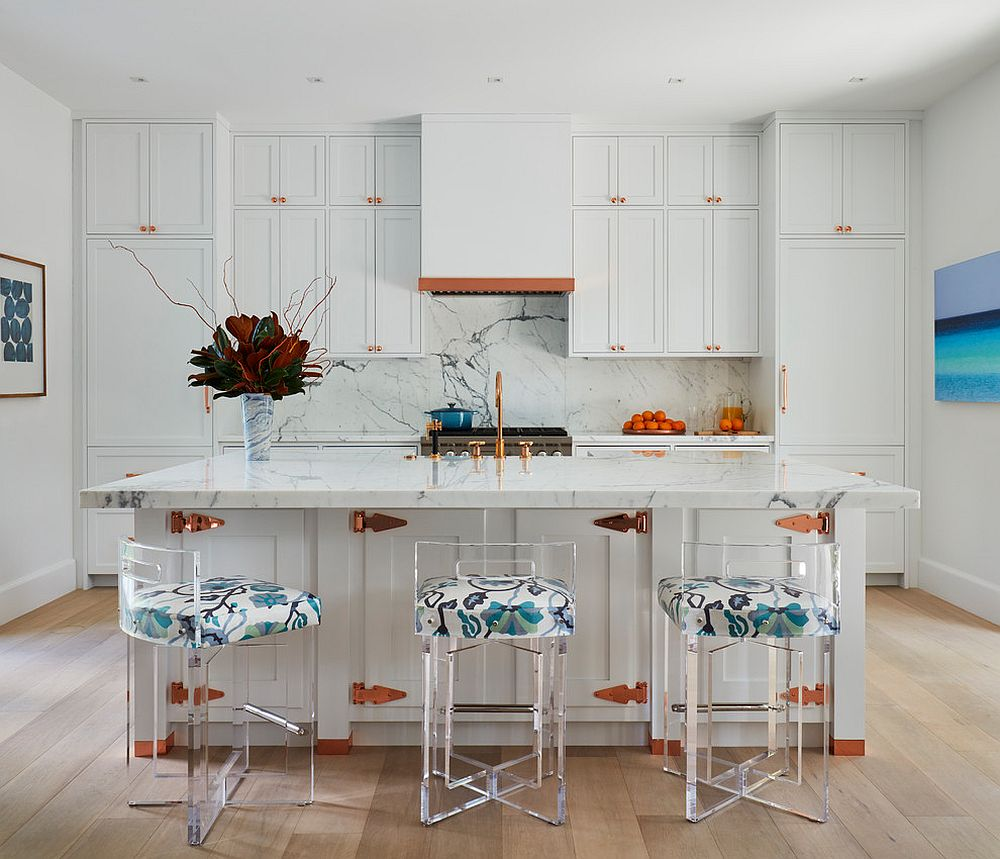 Polished beach style kitchen of Palm Beach home with acrylic bar stools