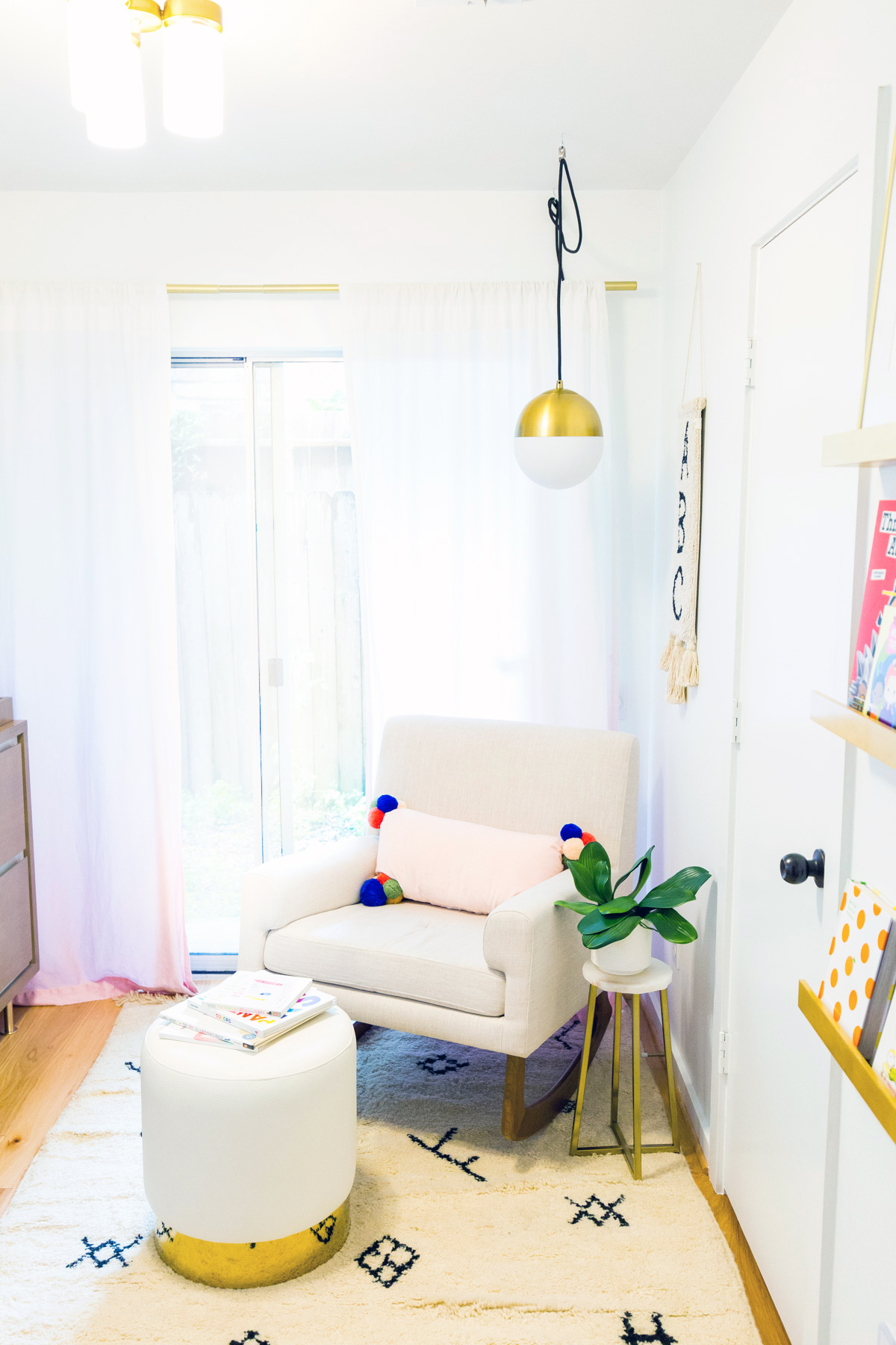 Pom poms and tassels in a nursery by Sugar and Cloth