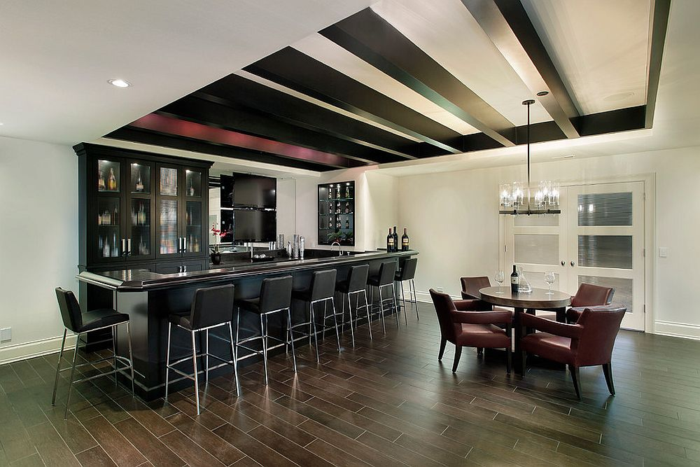 Posh black leather stools for the built-in home bar in the basement