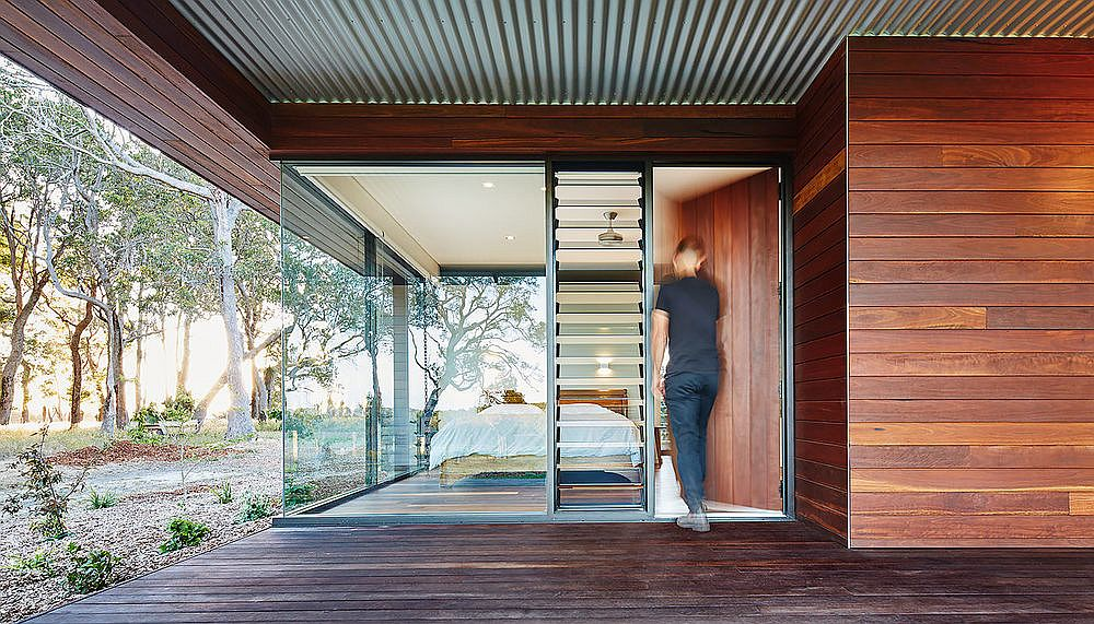 Rammed earth and wood give the house a naturally cool frame