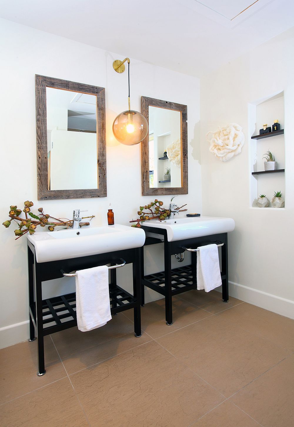 Recycled twin vanities in the bathroom coupled with vintage Danish pendant light