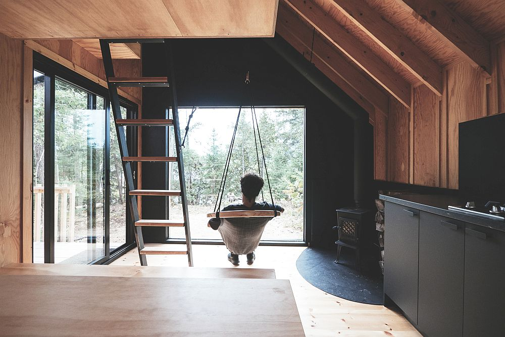 Relaxing interior and covered deck of the cabin with a view of the outdoors