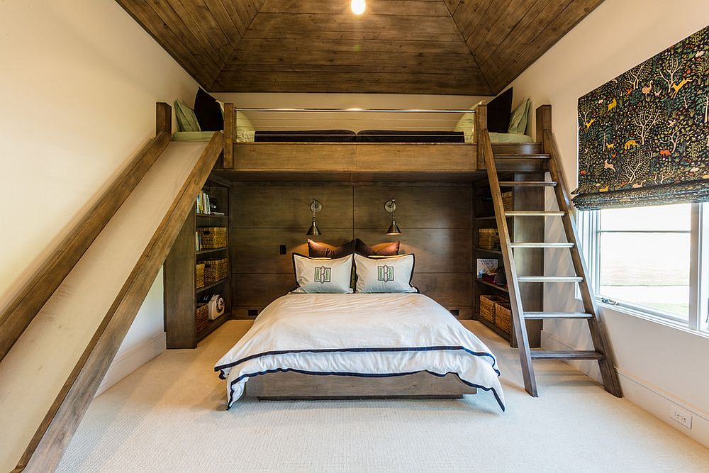Rustic bedroom with loft level bed and a cool slide