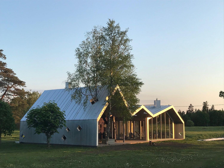 Sauna complex next to farmhouse in Estonia with a modern addition