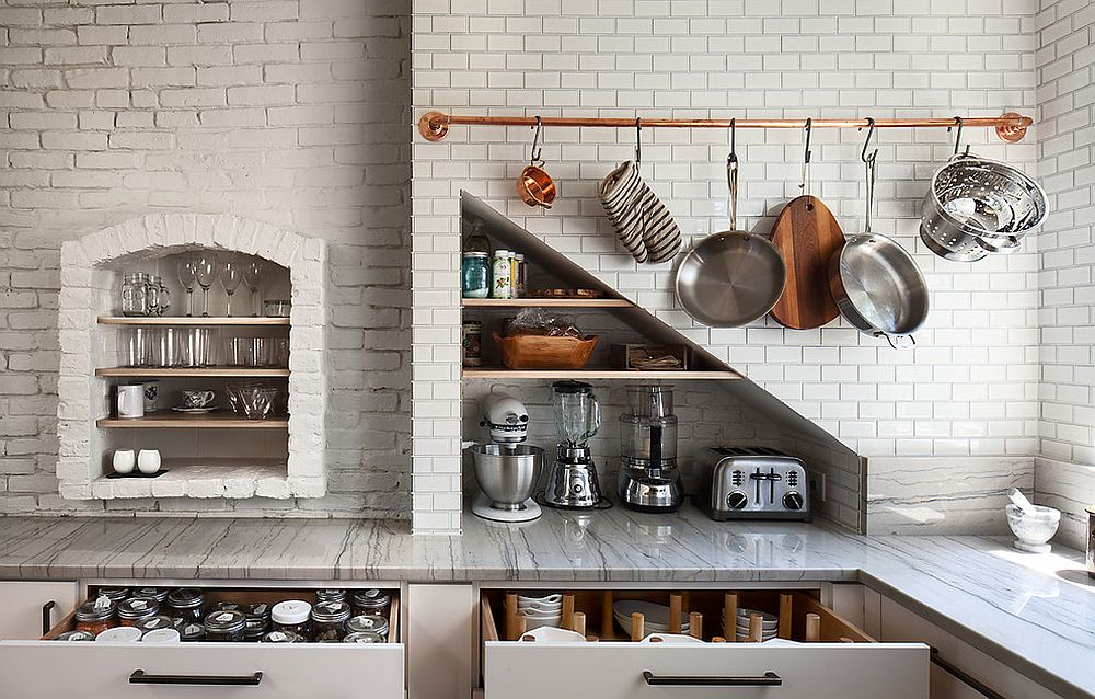 Scandinavian style kitchen in white with copper bar for hanging pots and pans