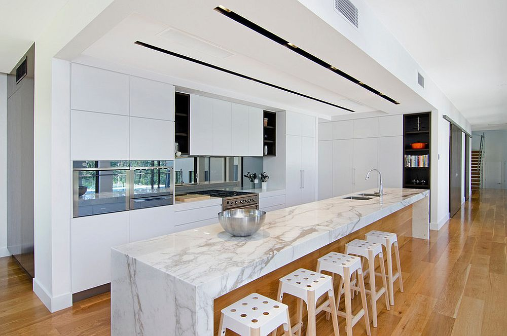 Simple approach to the wood and white kitchen design using a floor in wood
