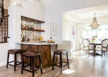 Space-under-the-stairway-turned-into-a-smart-and-simple-home-bar-with-ample-shelf-space-217x155