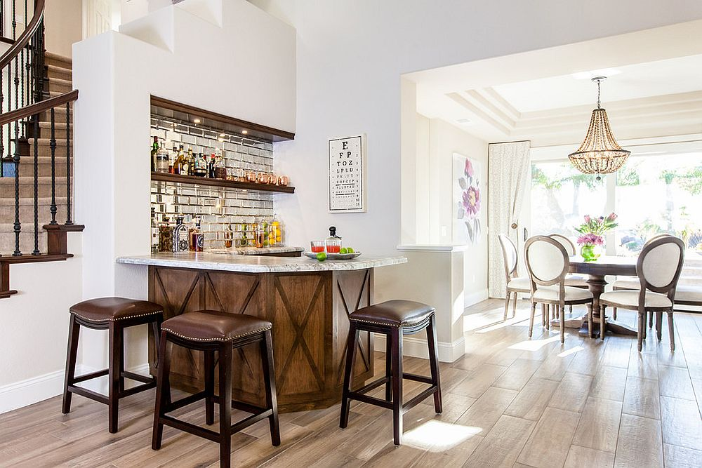 Space under the stairway turned into a smart and simple home bar with ample shelf space