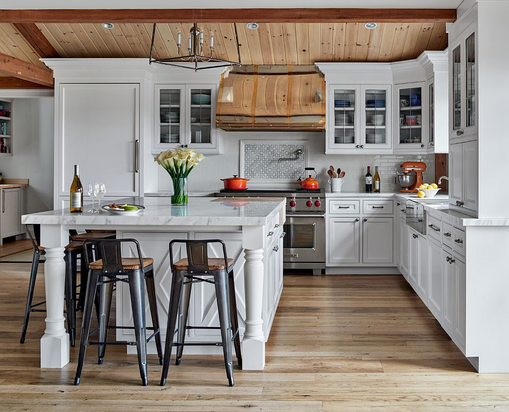 Spacious and well-lit farmhouse style kitchen in white and wood