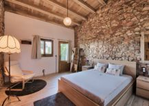 Stone-walls-give-the-rustic-bedroom-an-air-of-authenticity-217x155