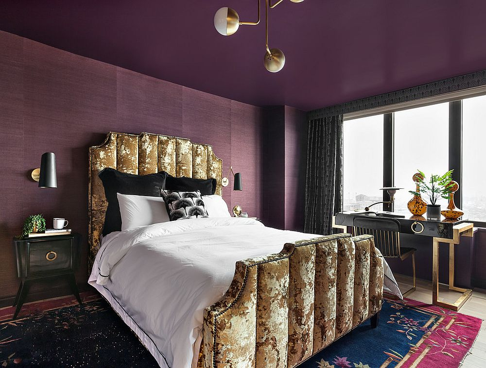 Striking bedroom where the ceiling is also purple!