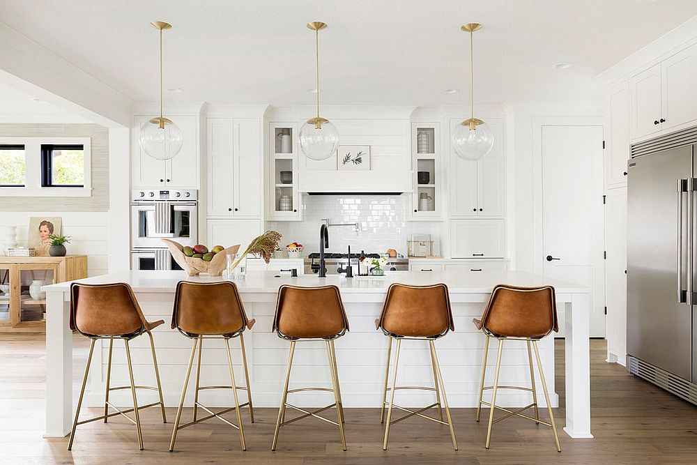 Striking use of leather bar stools in the modern farmhouse kitchen in white