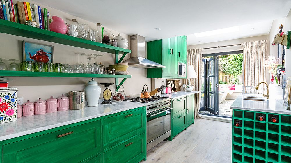 Stunning eclectic kitchen in white and green with cabinets that steal the spotlight