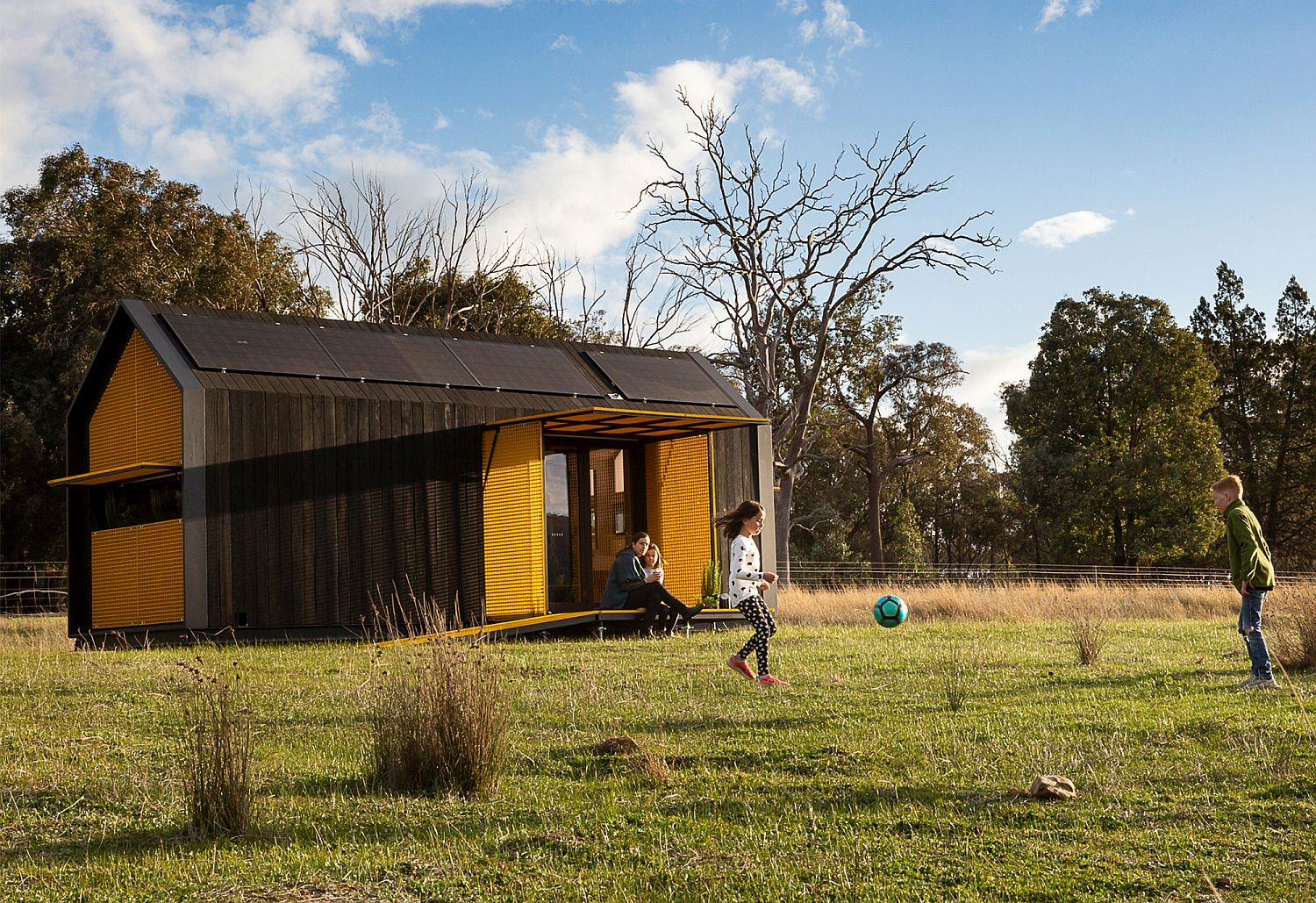 TIny home with gable roof and yellow shades that can be controlled with a smart device