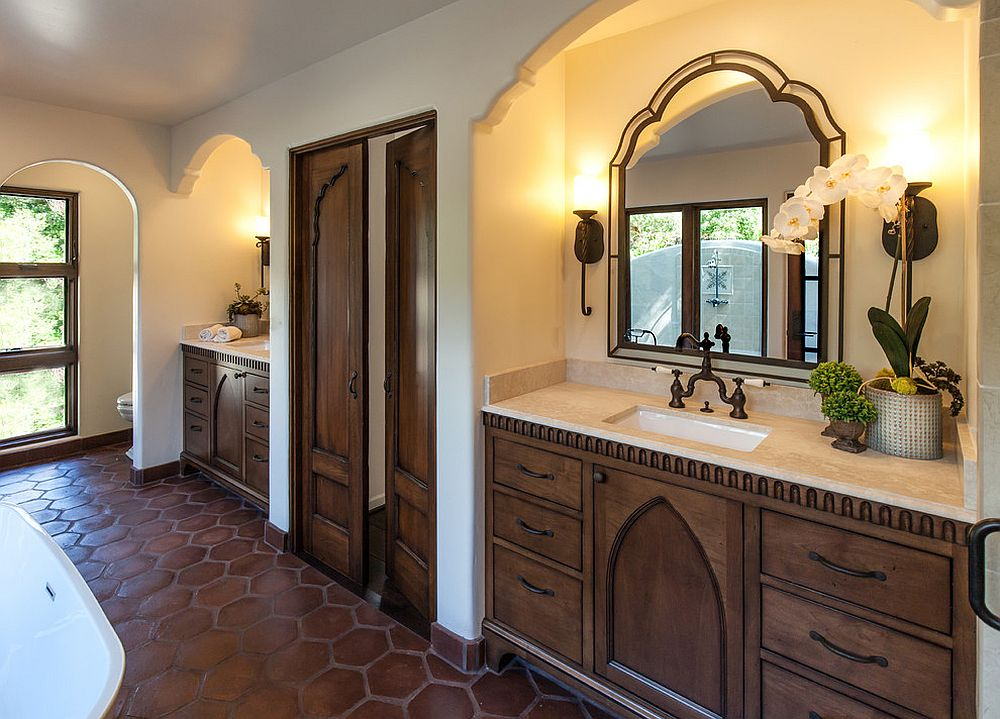Terracotta floor tiles and plastered walls bring old world Moroccan and Indian style to the bathroom