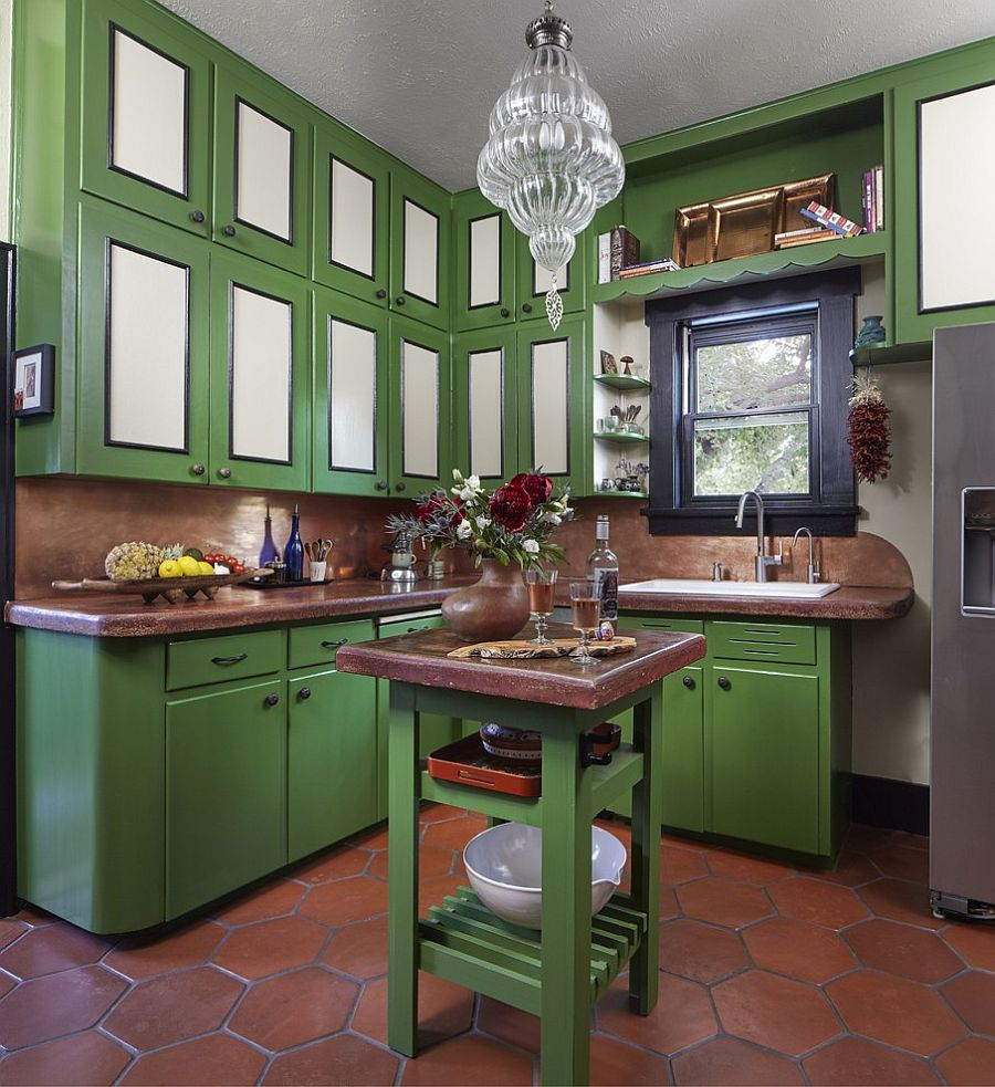 Terracotta tiles in the kitchen add classic touch to a space filled with ample green