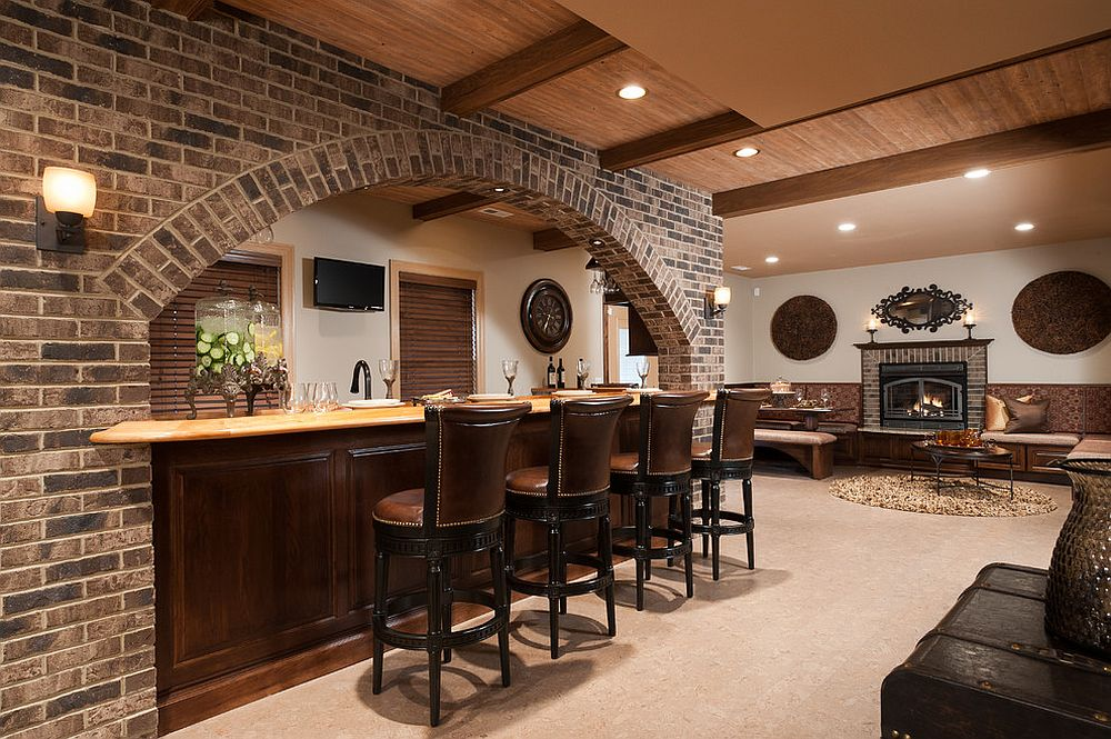 Traditional basement bar with brick face and bar stools in leather