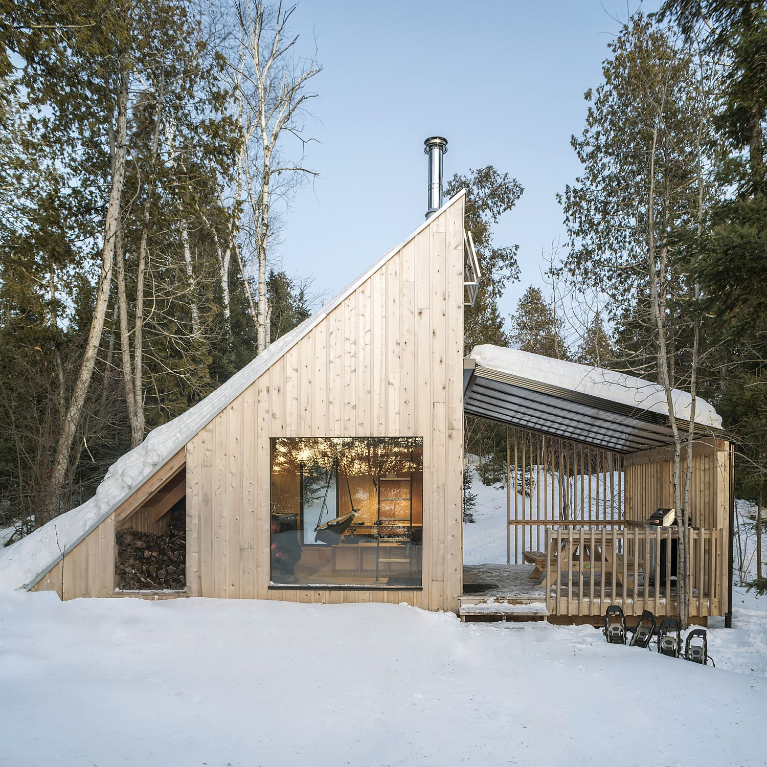 Triangular frame of the cabin is inspired by A-frame homes of the 50's