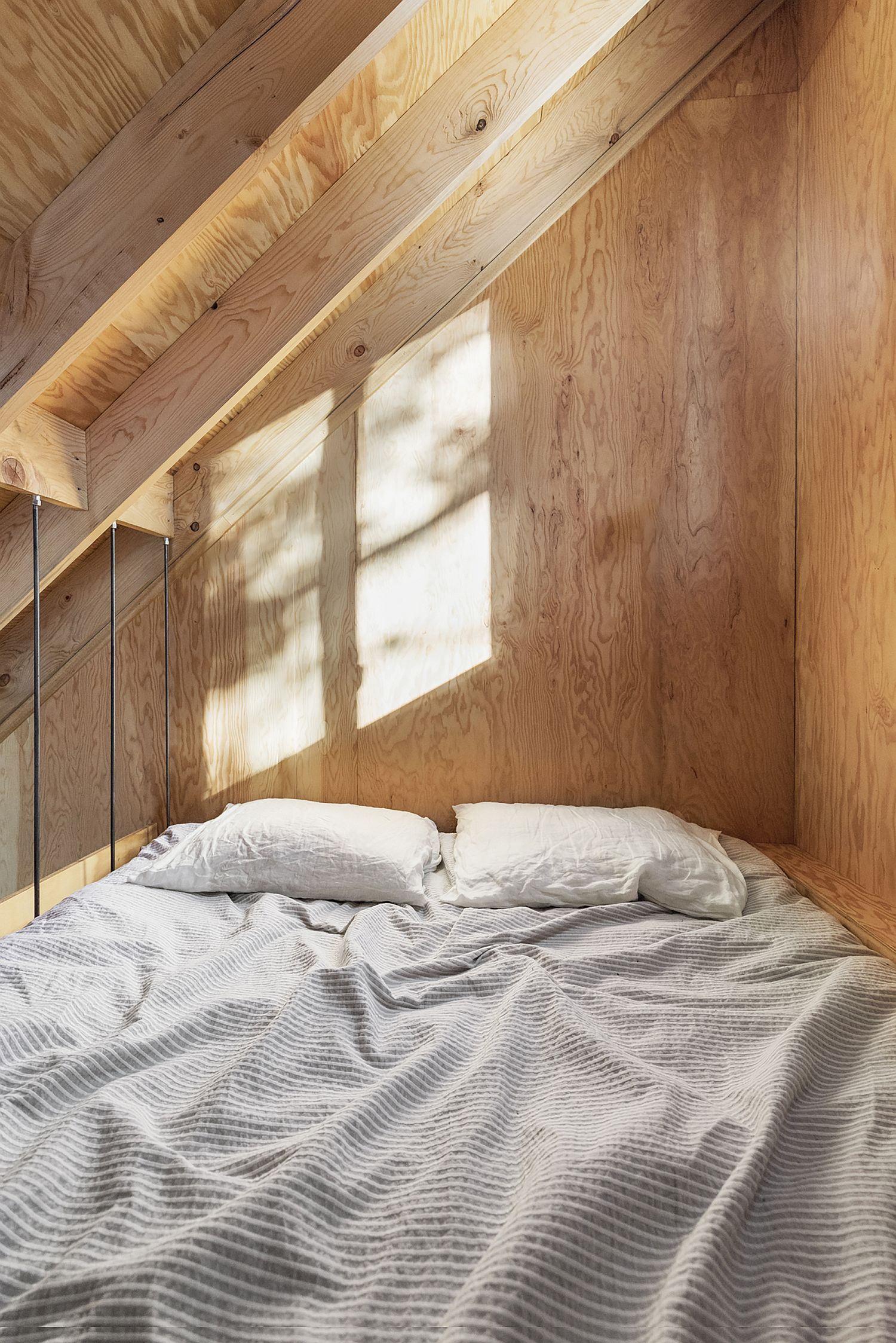 Upper level bedroom of the micro-shelter saves space with ease