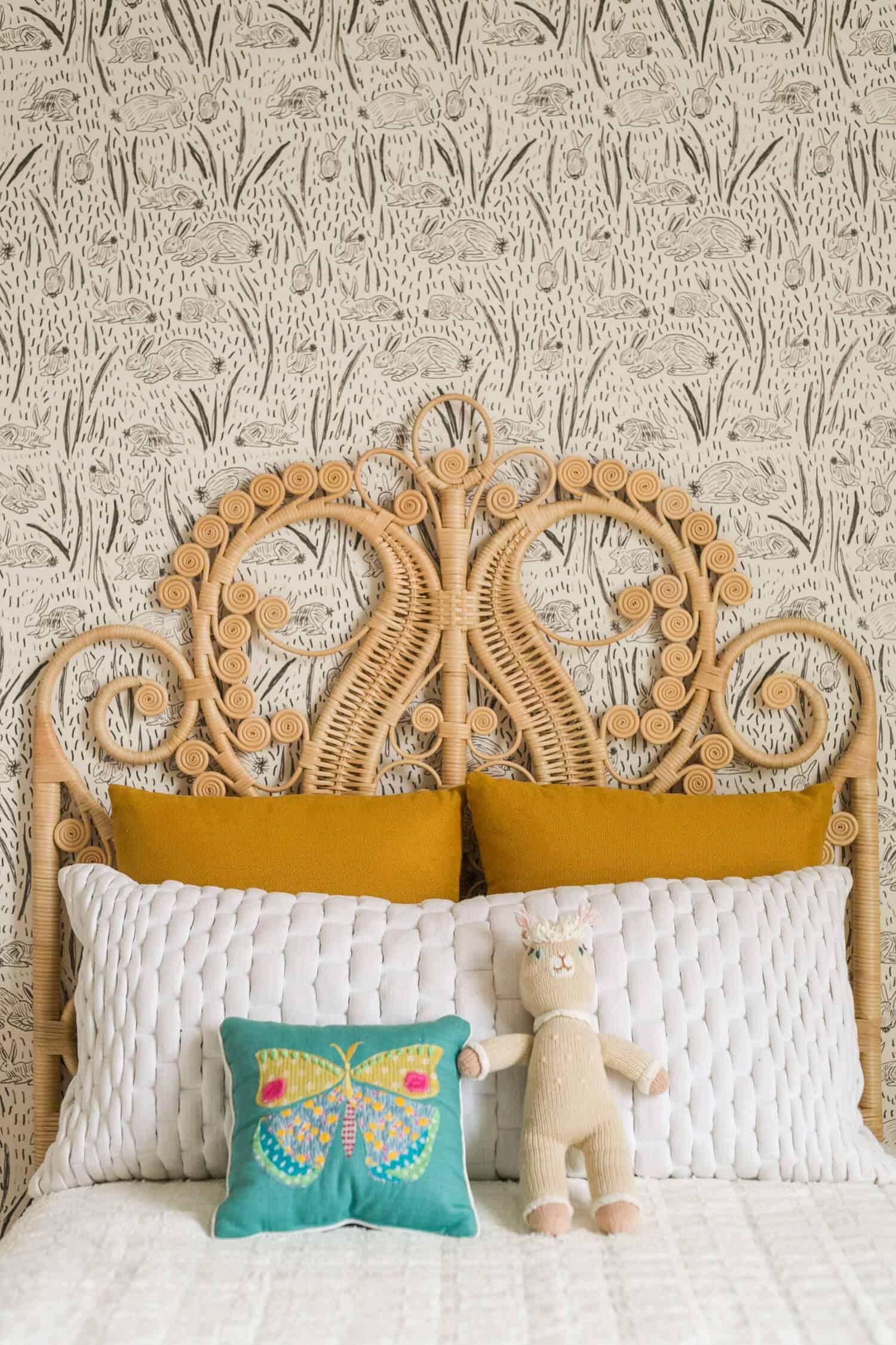 Wicker headboard in a toddler bedroom