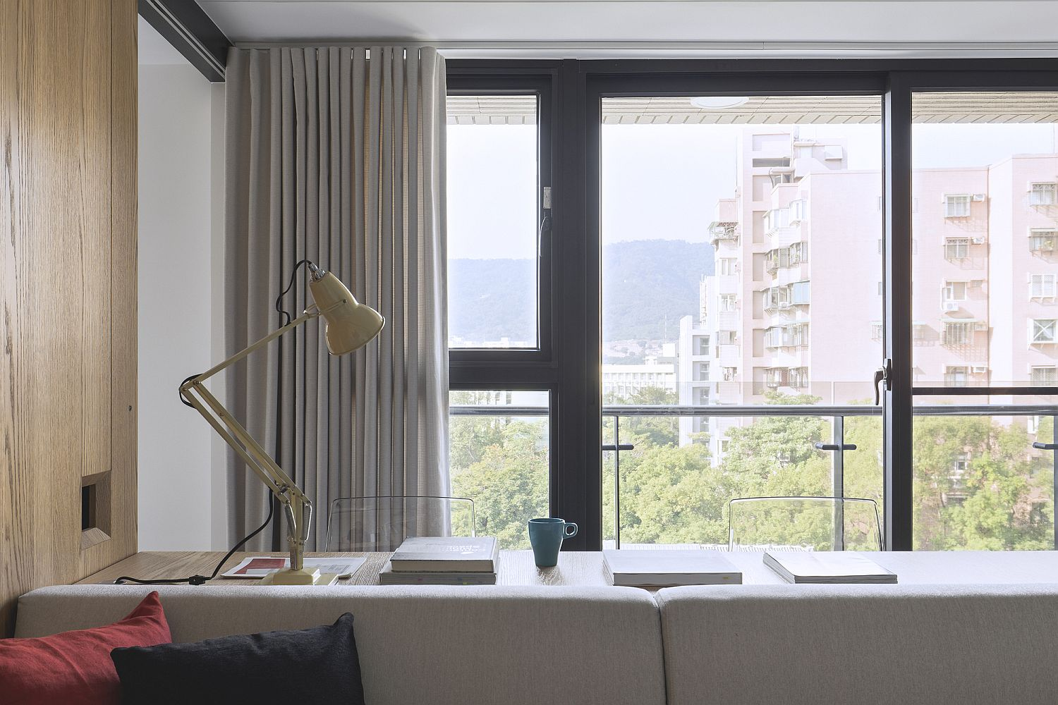 Windows and drapes usher in filtered natural light