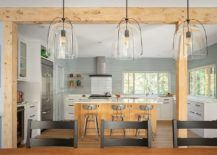 Wood-adds-warmth-and-elegance-to-the-modern-beach-style-kitchen-in-white-and-gray-217x155