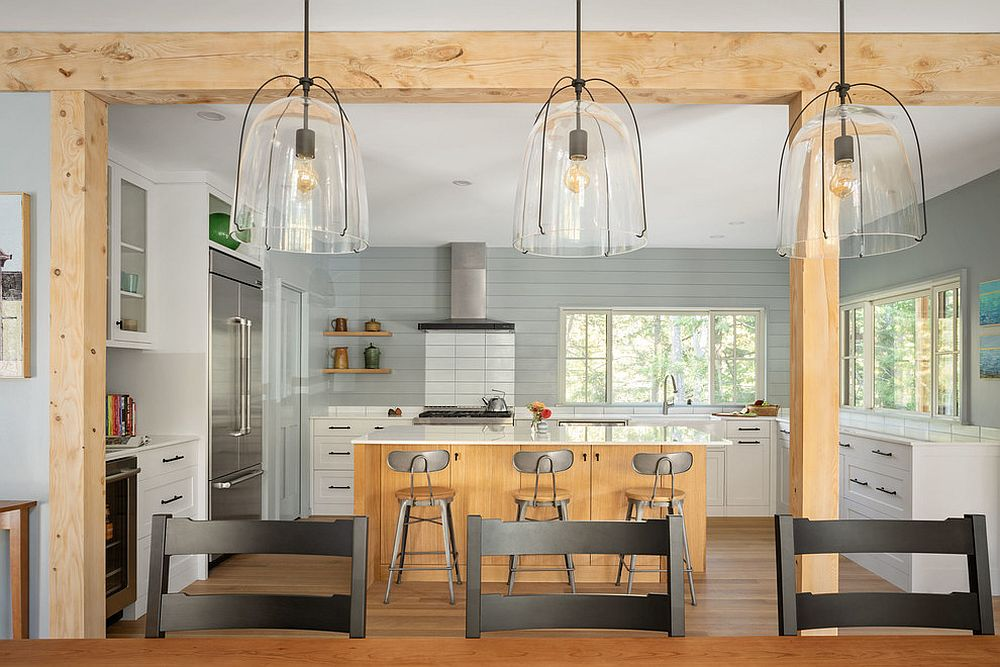 Wood adds warmth and elegance to the modern beach style kitchen in white and gray