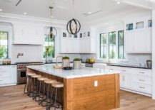 Wooden-island-with-stone-countertop-for-the-spacious-beach-style-kitchen-217x155
