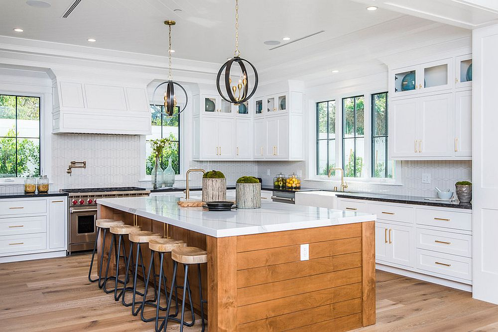 Wooden island with stone countertop for the spacious beach style kitchen