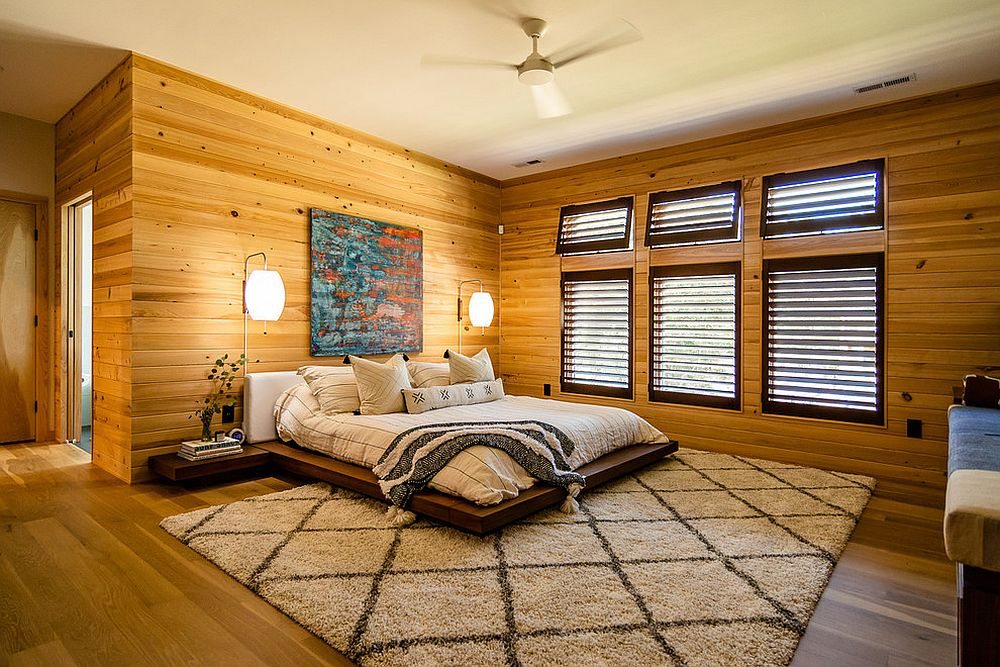 Wooden walls and platform bed give the room a stylish vibe