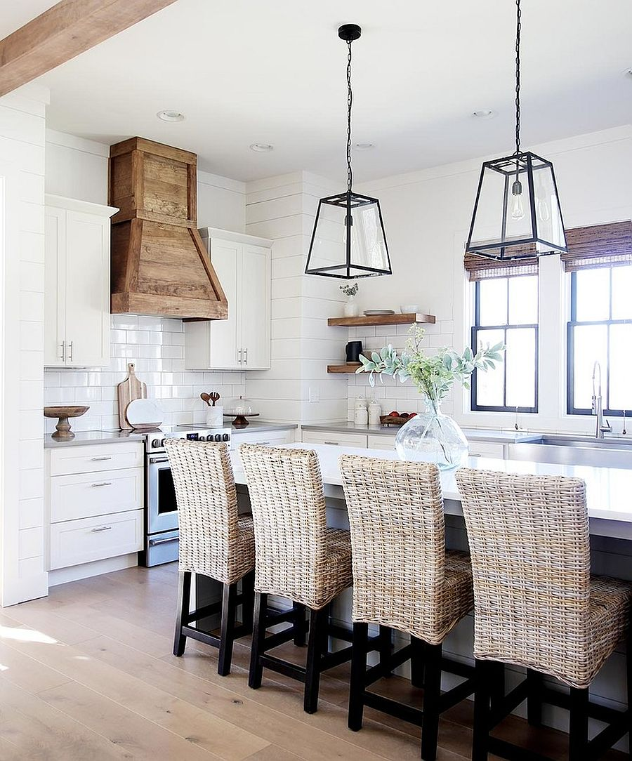 All-white kitchen with natural finishes and wooden flourish that affs warmth