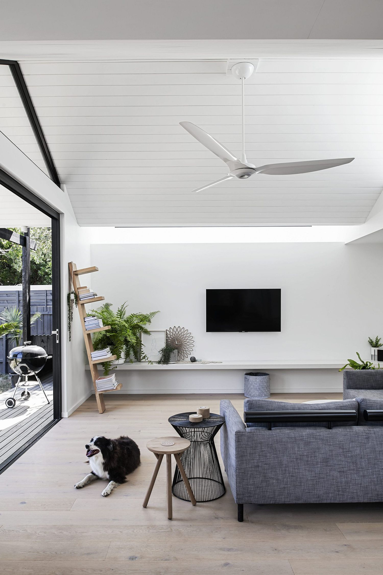 All-white living area of the new extension with a gray couch