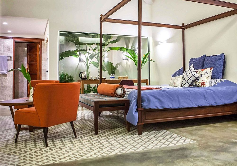 Atrium adds greenery to the setting while bedding ushers in blue
