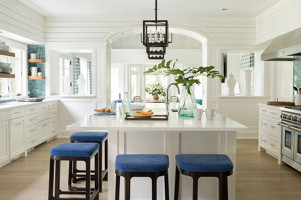 Bar stools and tile section in the corner bring a hint of blue to this white kitchen