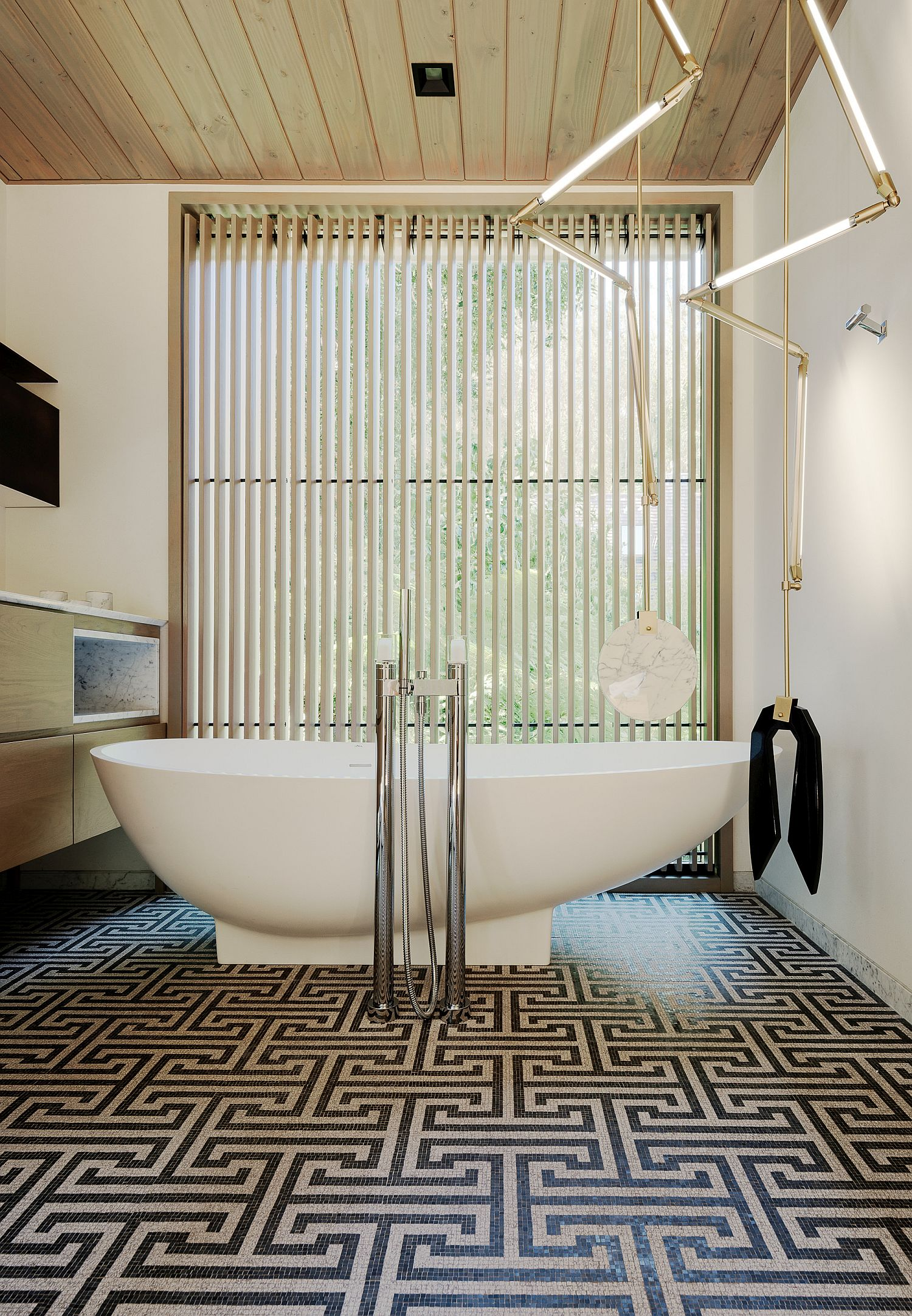 Bathroom in white with unique floor tiles and wooden ceiling