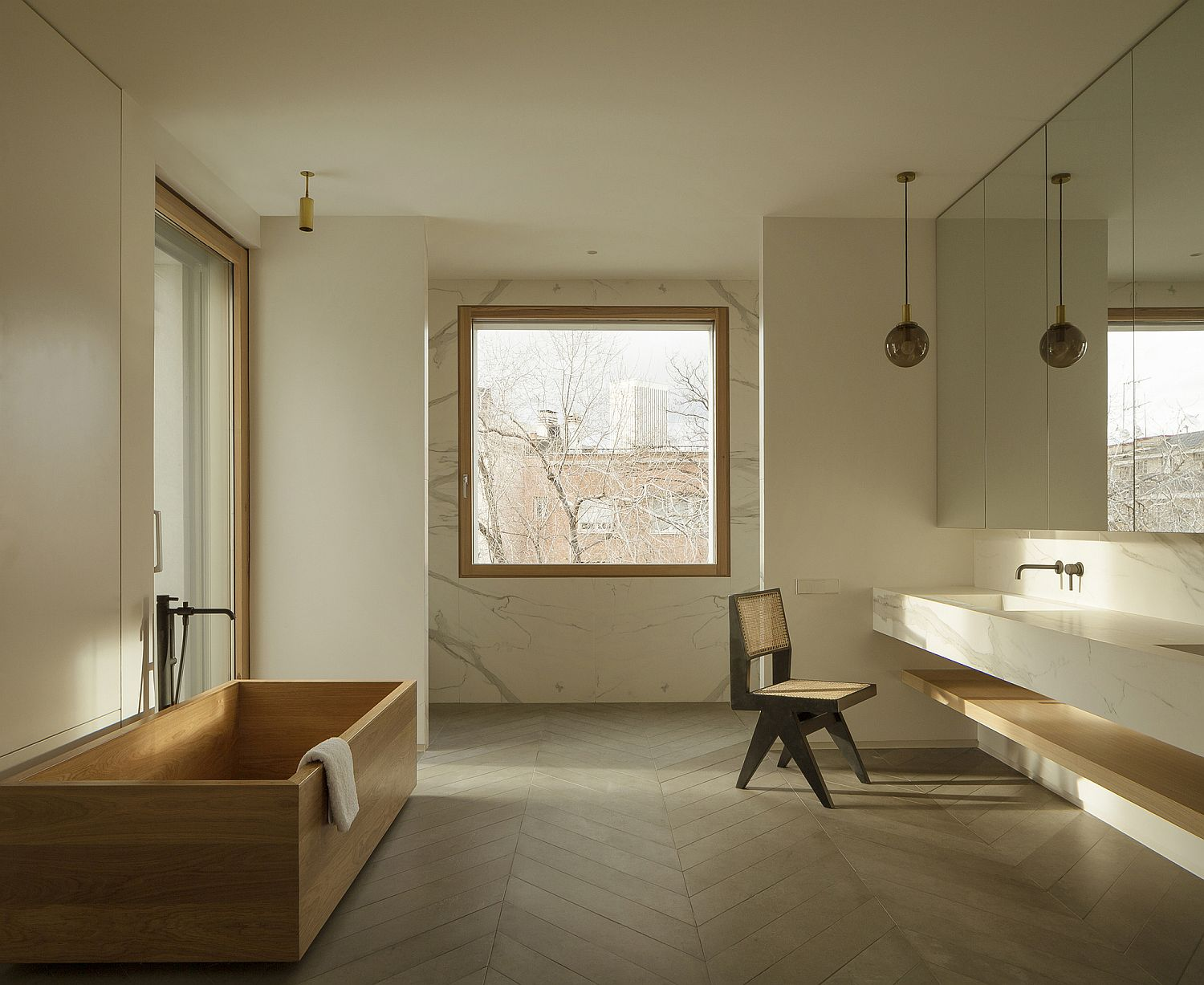 Beautiful bathroom with marble and wood and lovely natural lighting