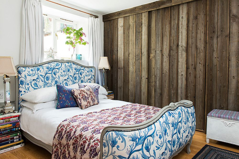 Bed frame and bedding brings flowery pattern to the bedroom