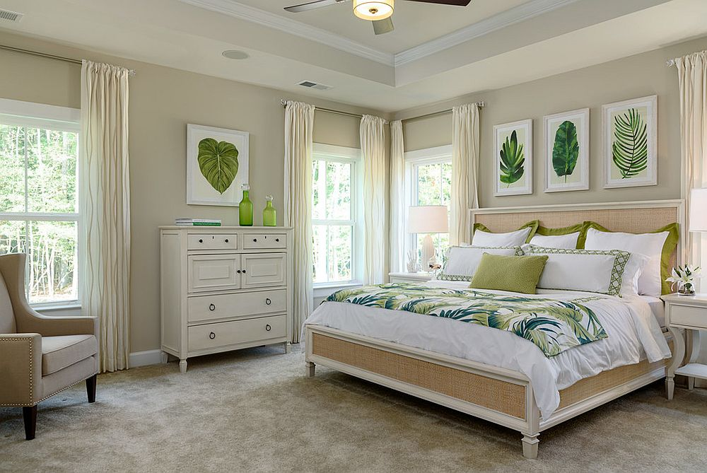 Botanical prints and bedding with leafy pattern for the modern tropical bedroom
