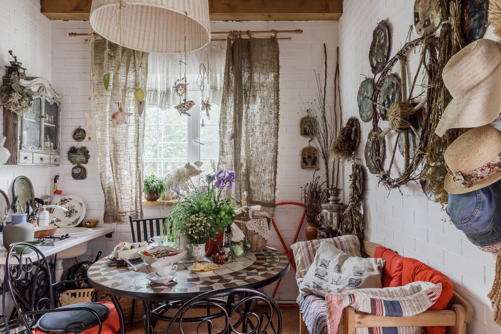 Casual shabby chic style dining room with a bit of eclectic appeal