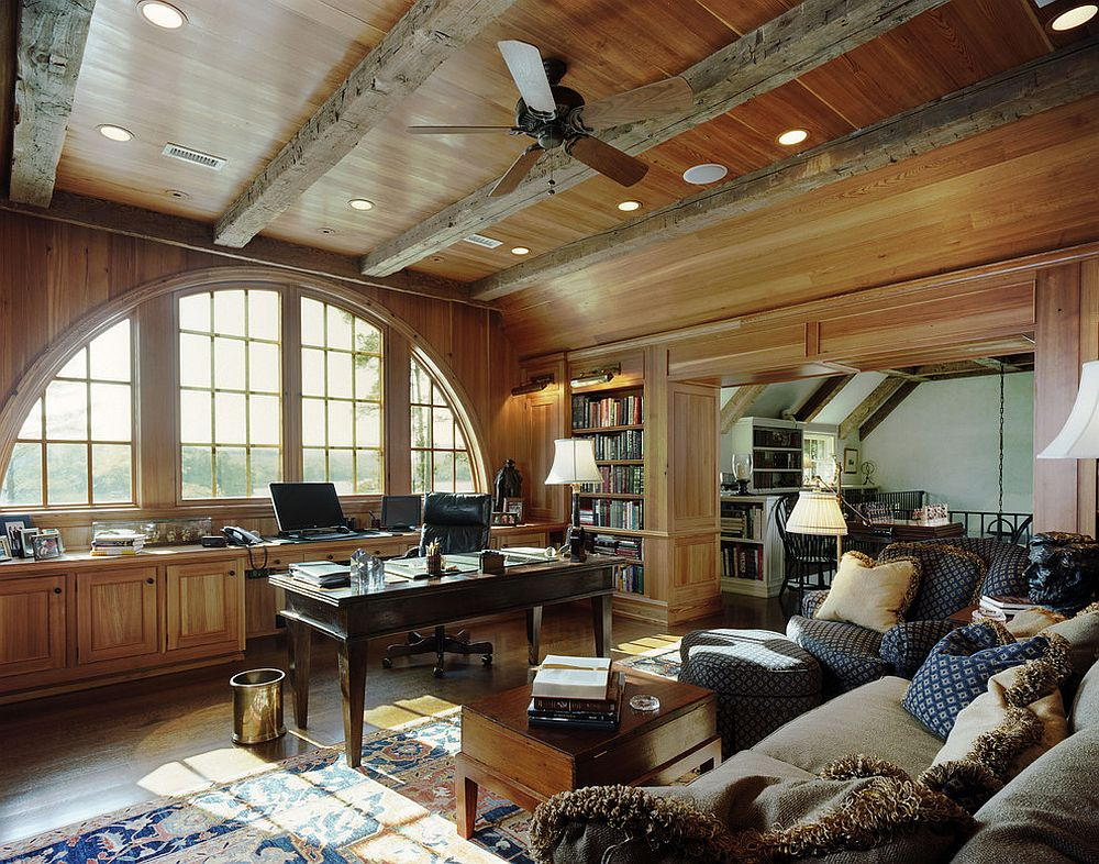 Ceiling beams with distressed finish add textural appeal to the traditional home office