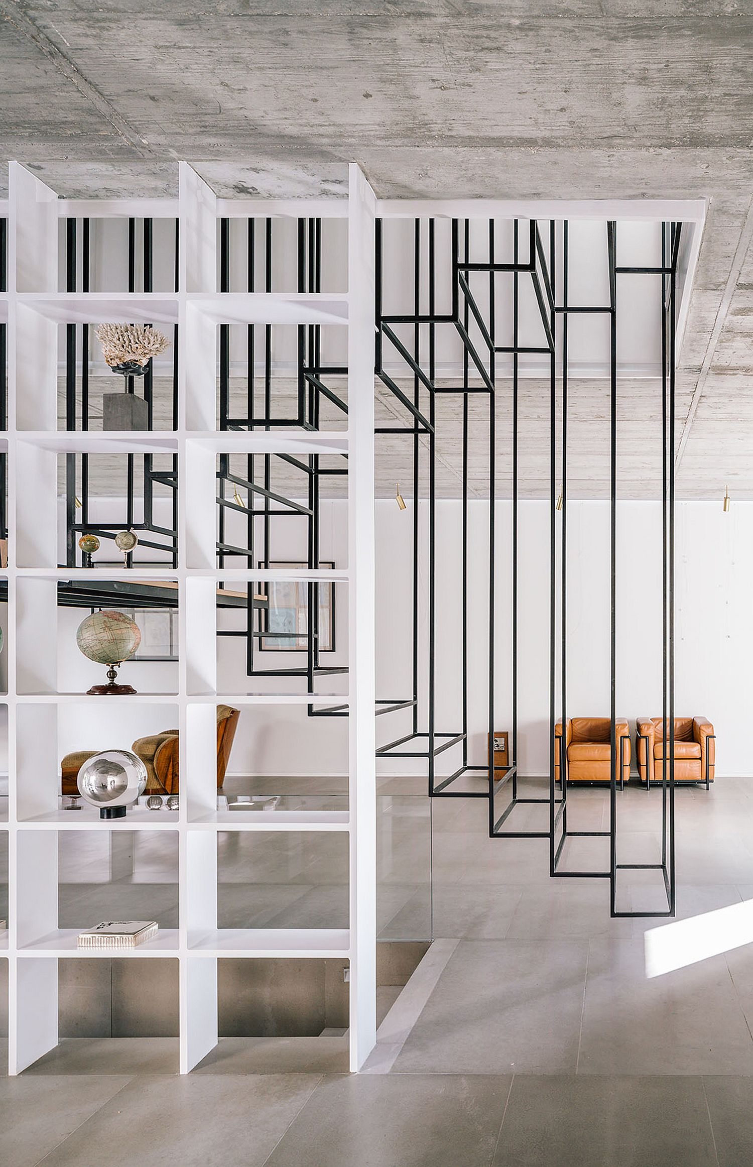 Central suspended light-weight stairway acts as a gorgeous aesthetic addition