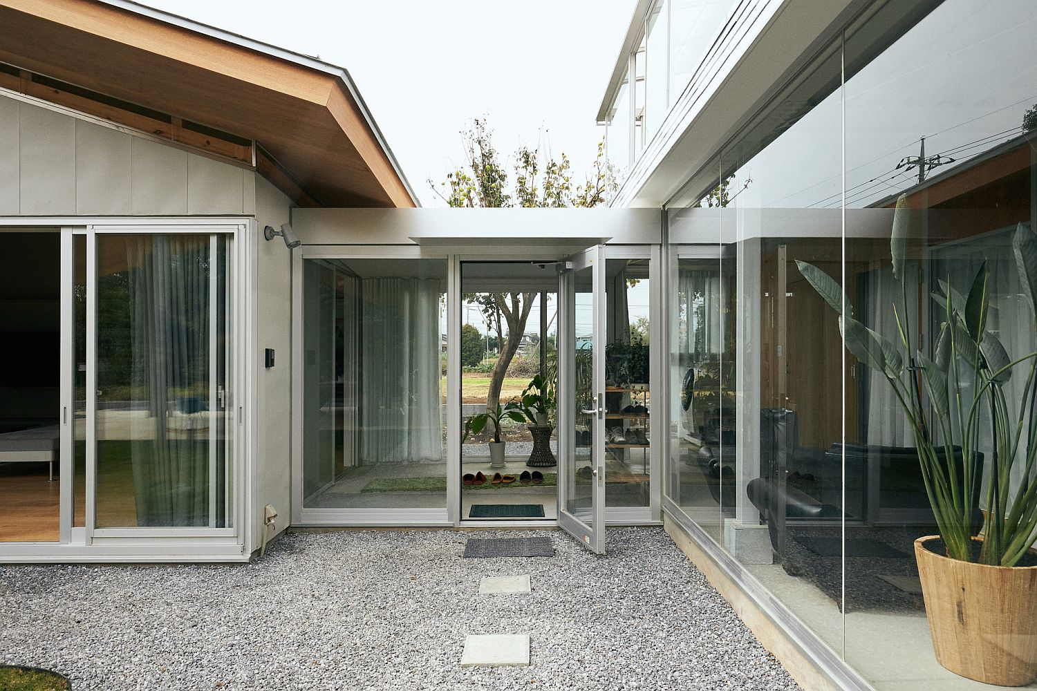 Covered walkways and multiple gardens add to the timeless appeal of the house