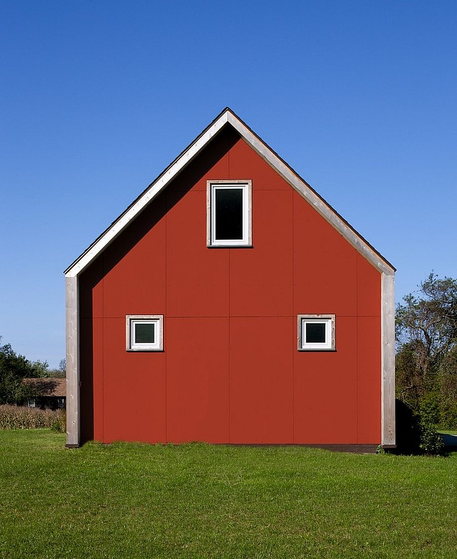 Eco-friendly-home-with-farmhouse-style-and-a-red-exterior